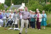 Four Villages Choir singing at Summer Solstice BBQ