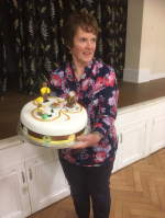 Brown Owl holding cake