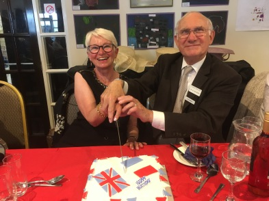 Chairman Mike Gallagher cutting the Union Jack cake