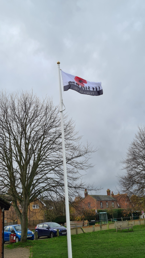 picture of Lest we forget flag flying on pole