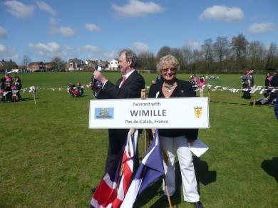 Chairman Viv Spratt holding Wimille twinning sign